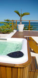 Spa jacuzzi outdoors. Modern spa jacuzzi outdoors under beautiful blue sky stock photo