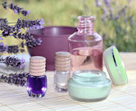 Spa lavender arrangement. Lavender creme on bamboo with a purple spa products and lavender flowers Royalty Free Stock Image