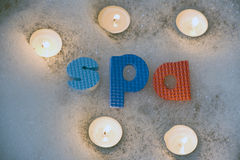 Spa letters with candles Stock Photos