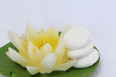 Spa life. Spa stil llife with lily candle,zen stone on the white background Royalty Free Stock Photos