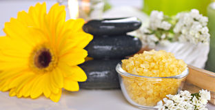 Spa life still. With yellow and white flowers, bath salts on unfocused background royalty free stock photography