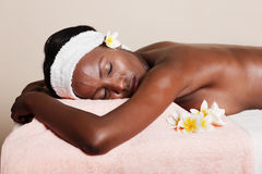 Spa lifestyle. Lifestyle, african american woman having a massage treat at the spa Stock Photo