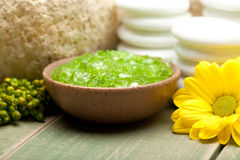 Spa - Lime bath salt and yellow flower Stock Images