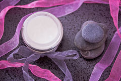 Daily spa, lotion and zen stones on black Stock Photography