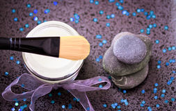 Daily spa, lotion and zen stones on black Royalty Free Stock Images