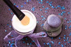 Daily spa, lotion and zen stones on black Stock Images