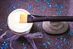 Daily spa, lotion and zen stones on black Royalty Free Stock Photo