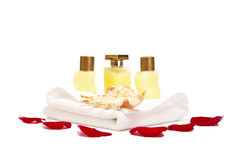 Spa lotions isolated on white. Spa lotion bottles with face towel and shell on it Stock Photos