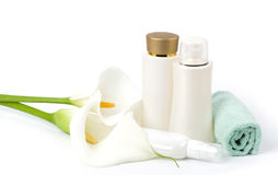 Spa lotions, white calla and towel. Beauty spa lotions, white calla and towel on white background Royalty Free Stock Image