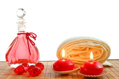 Spa love. Romantic spa or massage still life with red bottle oil Royalty Free Stock Image