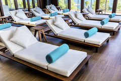 Spa luxury resort pool area. Hotel Spa luxury resort pool area with white lounge chairs Stock Photography