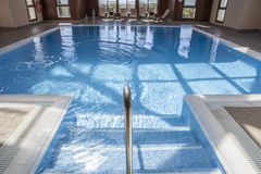 Spa luxury swimming pool with wooden structure skylight Stock Photography