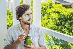 Spa man applying Facial green clay Mask. Beauty Treatments. Fres Royalty Free Stock Images