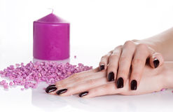 Spa manicure with aroma candle Royalty Free Stock Photo
