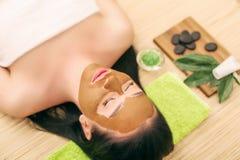 Spa Mask. Woman in Spa Salon. Face Mask. Facial Clay Mask. Royalty Free Stock Photos