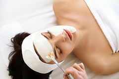 Spa Mask. Woman in Spa Salon. Face Mask. Facial Clay Mask. Stock Photo