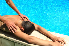 Spa massage. Young guys make the voyage after a relaxing massage Stock Photo