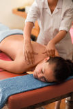 Spa Massage. Young woman getting massage at spa Stock Photo