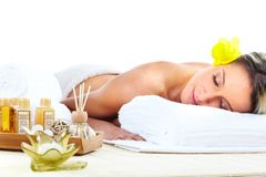 Spa massage. Beautiful young woman getting spa massage Royalty Free Stock Photo