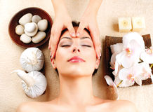 Spa Massage. Young Woman Getting Facial Massage royalty free stock image