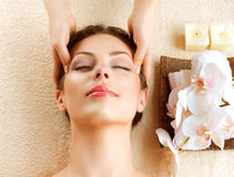 Spa Massage. Young Woman Getting Facial Massage royalty free stock photos