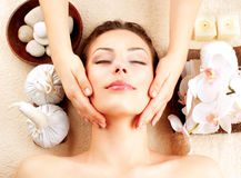 Spa Massage. Young Woman Getting Facial Massage stock photos