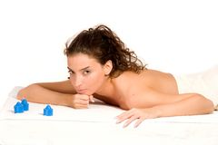 Spa and Massage. Beautiful young woman relaxing at spa - against white Stock Photos