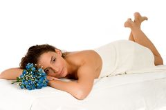 Spa and Massage. Beautiful young woman relaxing at spa - against white Royalty Free Stock Image