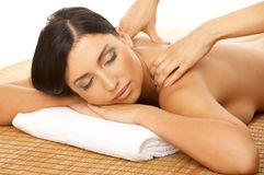 Spa and Massage. Portrait of Fresh and Beautiful brunette woman taking massage Stock Photos