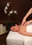 Spa massage. A woman in a spa getting a relaxing massage Royalty Free Stock Images