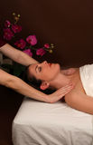Spa massage. A woman in a spa getting a relaxing massage Stock Photos