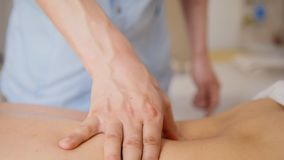 Spa. In the massage bank create a vacuum against the background of a woman. Spa. In the massage bank create a vacuum with alcohol wadding and fire against the Stock Photo