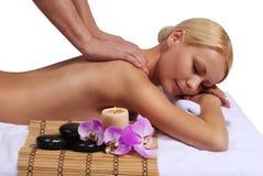 Spa Massage. Beautiful Blonde Woman Getting Body Massage. Isolated on white. Beauty Treatments Royalty Free Stock Photos