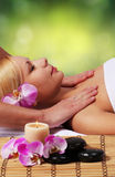 Spa Massage. Beautiful Blonde Woman Getting Body Massage. Royalty Free Stock Photo