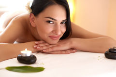 Spa Massage. Beautiful Brunette Gets Spa Treatment in Salon. Royalty Free Stock Images