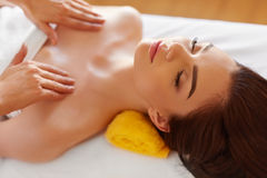 Spa Massage. Beautiful Woman Gets Spa Treatment in Salon. Stock Photography