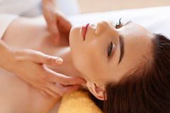 Spa Massage. Beautiful Woman Gets Spa Treatment in Salon. Stock Photos