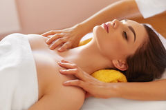 Spa Massage. Beautiful Woman Gets Spa Treatment in Salon. Royalty Free Stock Images