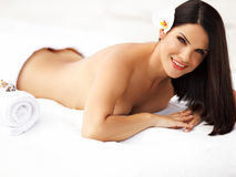 Spa  Massage. Beautiful Young Woman Relaxing after Massage. Royalty Free Stock Image