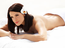 Spa Massage. Beautiful young woman relaxing after massage. royalty free stock images