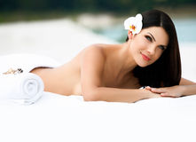 Spa Massage. Beautiful young woman relaxing after massage. stock photography