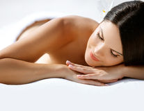 Spa Massage. Beautiful Young Woman Relaxing after Massage. royalty free stock photography