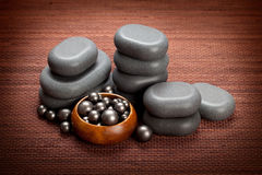 Spa massage - black stones Stock Photos