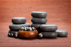 Spa massage - black stones Royalty Free Stock Image