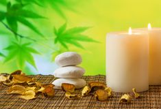 Spa massage border background with candle near stone and wood Royalty Free Stock Image