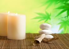 Spa massage border background with candles near stone and wood Royalty Free Stock Photography