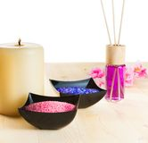 Spa massage border background with perfume diffuser and sea salt Stock Photos