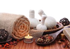 Spa massage border or background. With rolled towel, compress balls and candlelight Royalty Free Stock Image