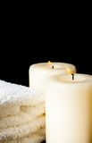 Spa massage border background with towel stacked and candles Stock Photos