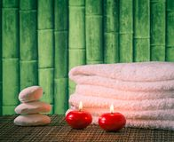 Spa massage border background with towel stacked candles and sea salt Stock Photography